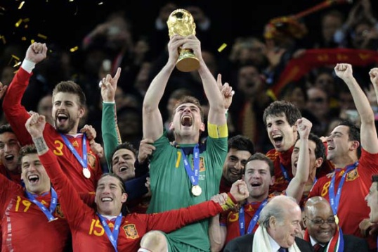 Spain goalkeeper Iker Casillas holds up the World Cup trophy.